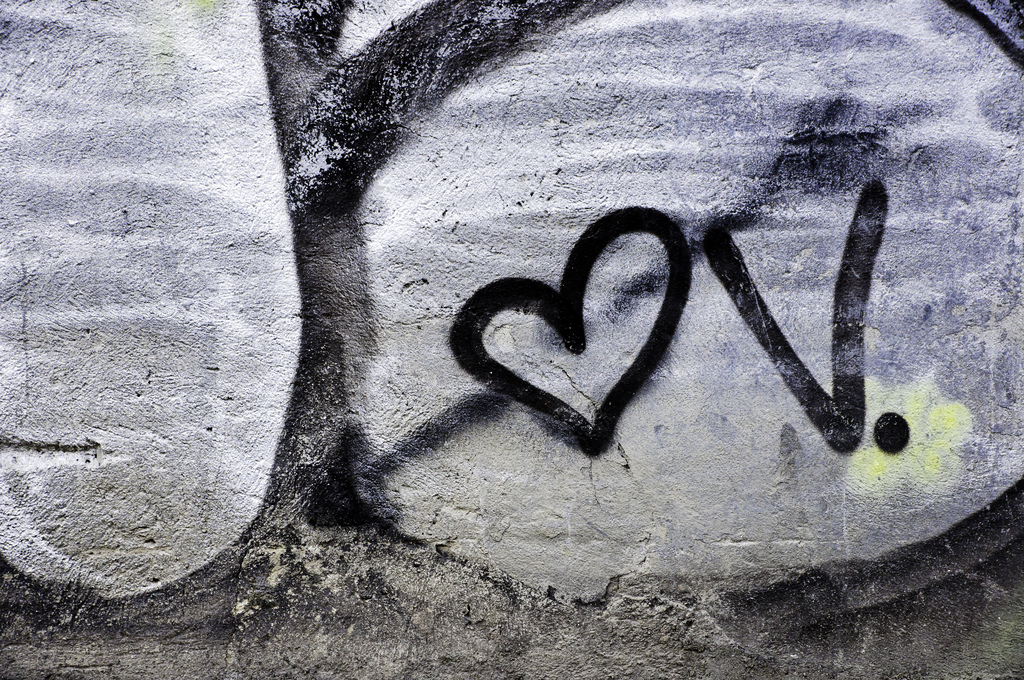 Graffiti of letter v next to a cupid's heart